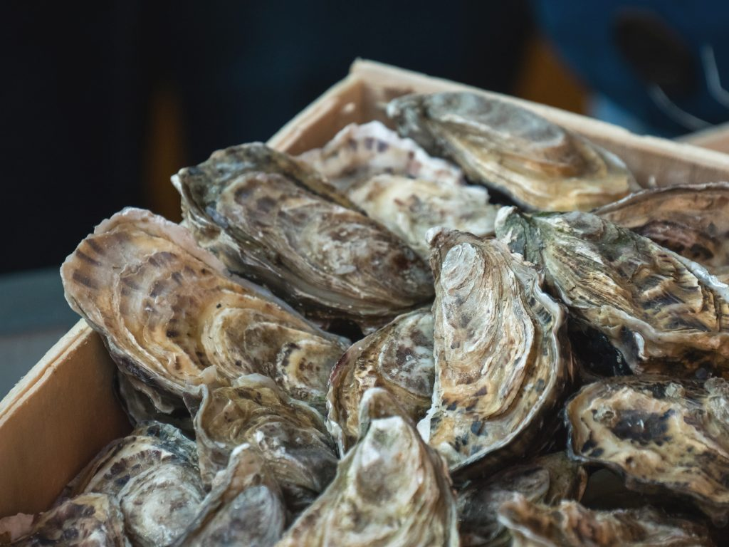 Oysters,On,The,Counter,In,Wooden,Boxes,On,The,Market.