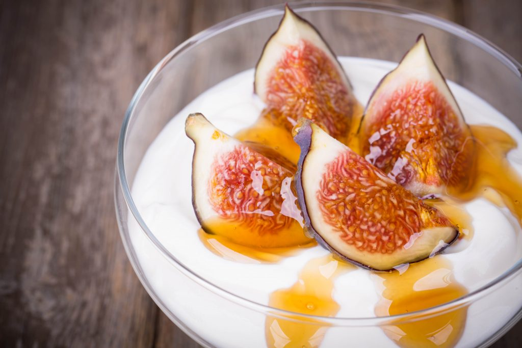 Greek,Yogurt,With,Figs,And,Honey,,In,A,Glass,Bowl
