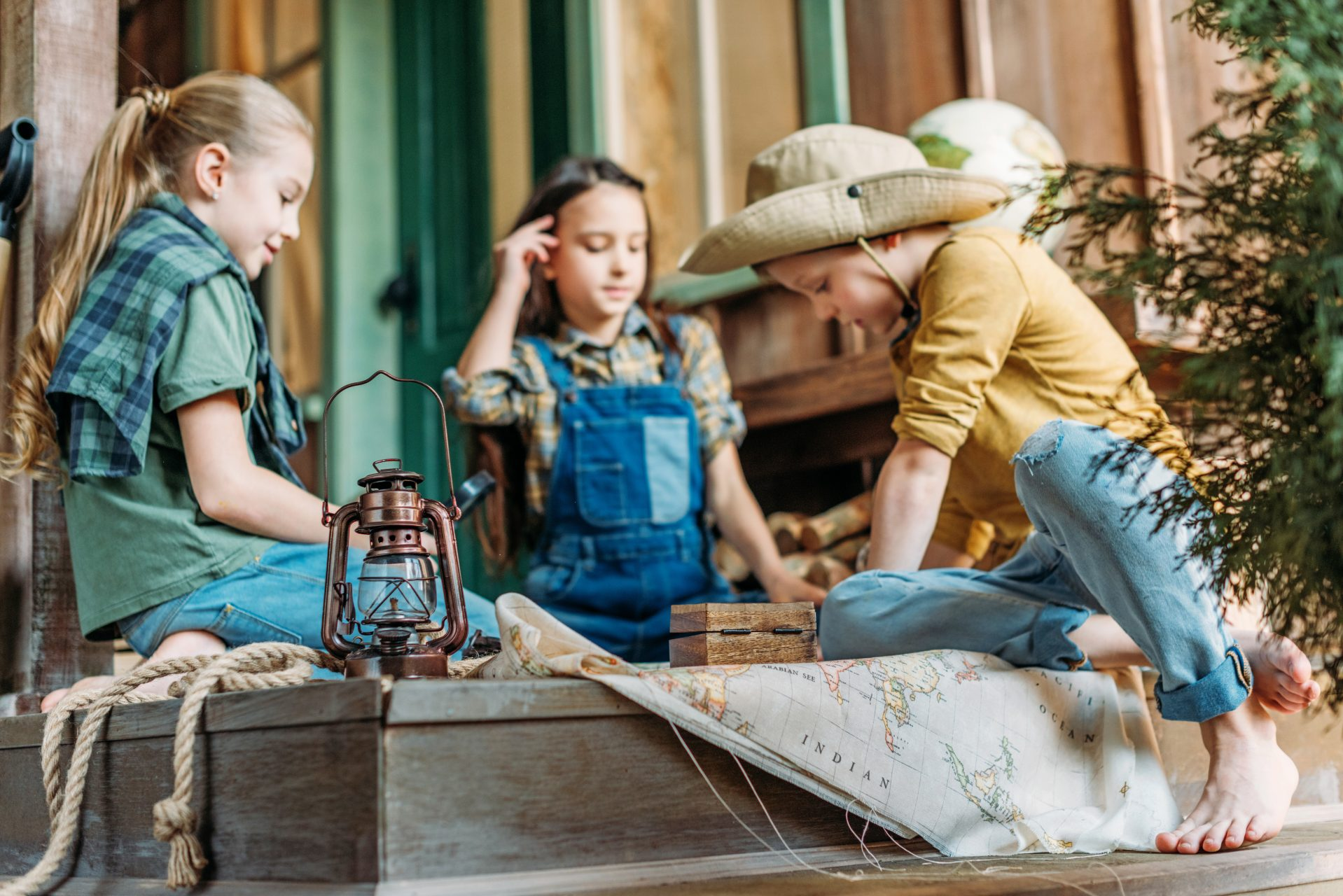 Cute,Kids,Playing,Treasure,Hunt,With,Map,On,Porch